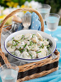Potato salad with mayonnaise and herbs