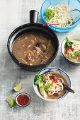 Hotpot with lamb, pasta and bok choy (Asia)