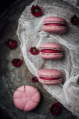Pink macarons on a cheesecloth
