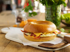 A bagel filled with egg, cheese and bacon
