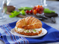A croissant filled with tuna salad