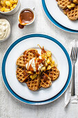 Maple syrup waffles with poached apples and bourbon caramel sauce