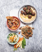 Ostrich falafel with harissa hummus, baked ricotta spread, smoked fish dip with vegetables and roasted nuts