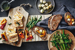An antipasti plater with pumpkin and ricotta frittata, green beans, asparagus, basil pesto, grilled bread, mini peppers and marinated bocconcini