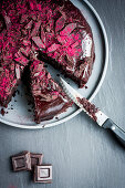 Lactose-free chocolate beetroot cake with raspberry powder