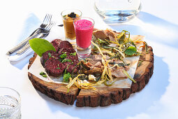 A meat platter with sauces (Ukraine)