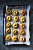 Half baked apples on a baking tray