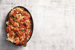 Spaghetti puttanesca with tuna balls