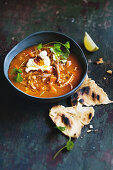 Slow-cooker spiced split-pea soup with harissa labneh