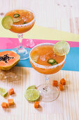 Papaya margaritas with jalapenos and limes