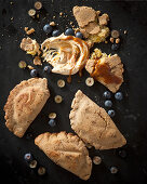Sweet dumplings filled with bananas, dulce du leche, sour cream and blueberries