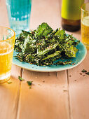 Deep fried broccoli leaves and beer