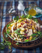 Warm chicken salad with cranberry and walnut sprinkle