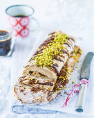 Meringue roulade with pistachios