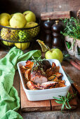 Roasted pork fillet with apples and rosemary