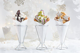 Three bubble waffles with frozen yogurt and Christmas sweets