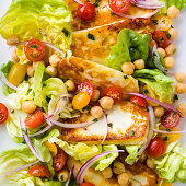 Pan fried Halloumi cheese with cherry tomatoes, chickpea and lettuce