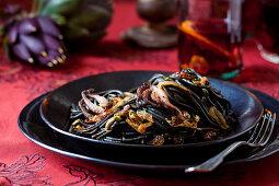Dinner talbve settign with Black Pasta and Octopus