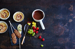Chocolate fruits, praline pudding and chocolate lollies