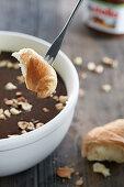 Nutella fondue with croissants