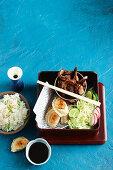 Bento box with teriyaki beef and gyoza
