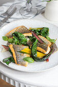 Fish with chard and basil