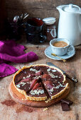 Chocolate tart with poached red wine pears