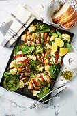 Hasselback chicken with lemon-roasted broccoli