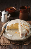 Poke cake: lemon cheesecake with icing, sliced