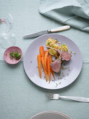 Saddle of lamb with anise and spiced carrots served with a warm potato and lentil salad with cress