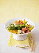 Rocket salad with mango, mozzarella and Parma ham