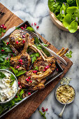 Spiced lamb cutlets with labne, dukkah and pomegranate