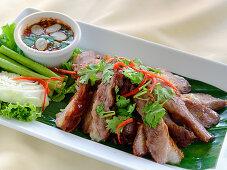 Kor Moo Yang (grilled pork neck, Thailand)