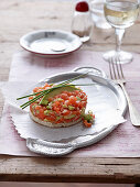Salmon tartare with avocado on a silver tray