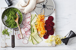 Avocado and broccoli medley, sliced radishes, courgette and beetroot and carrot spaghetti