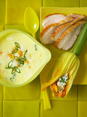Lemon soup with chicken breast and stuffed courgette flowers