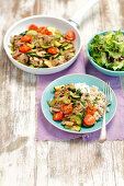 Fried mushrooms with courgette and cherry tomatoes served with barley