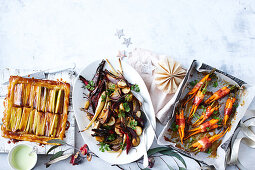 Prosciutto-wrapped baby carrots with maple glaze - Boozy baked root vegetables - Leek tarte tatin