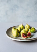 Fresh yellow tiger figs on a dish