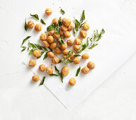 Macadamia nuts with curry powder, curry leaves and sea salt flakes
