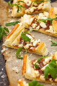 Savory puff pastry slices with caramelised onions and goat's cheese