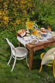 Table set for Easter breakfast in garden