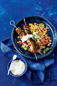 Moroccan lamb skewers with peperonata couscous