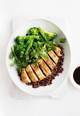 Sesame chicken with black rice, sugar snaps and broccolini