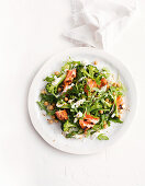 Spiced salmon with chickpea, broccoli and rocket salad with yoghurt dressing