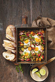 Harissa vegetable and egg tray bake