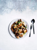 Coal-fired clams in garlic brown butter