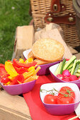 Fresh vegetables and a hamburger bun for a barbecue