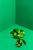 Green peppers on a green surface