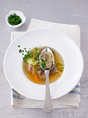 Beef broth with vegetables and herbs